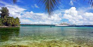 Luxury motor yacht anchored off beach in Thialand