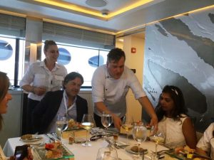 Chef Pano of Greek Motor Yacht Barents Sea serving the main course during lunch at the 2017 Greek Yacht Show in Nafplion.