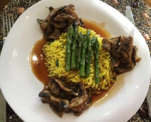 Marinated Mushroom Saffron Orzo with steamed asparagus and Mavrodafni wine sauce