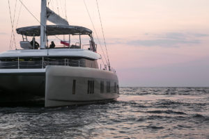Sunreef 50 Catamaran sailing at sunset