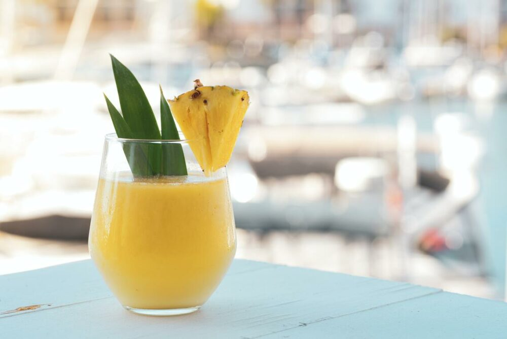 catamaran charter tropical drink with pineapple garnish